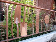 If you've got welding skills, this is a cool way to incorporate old tools into an interesting fence. via wanderingone on flickr