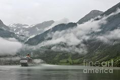 Cruise ship docked in Geiranger in a foggy day, Norway