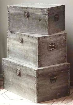 Distressed Metal & Wood Trunks...love. End table?  Perhaps?  Just maybe?