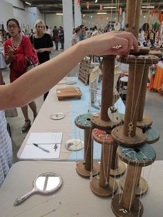 Necklace display on repurposed vintage old wooden spools, add tacks, for arts and crafts show booth, retail store display or cottage style home decor; Upcycle, Recycle, Salvage, diy, thrift, flea, repurpose! For vintage ideas and goods shop at Estate ReSale ReDesign, Bonita Springs, FL