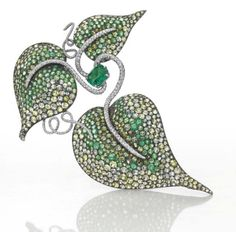 This important 'Leaf' brooch, by JAR, 1989, first sold at Christie's in 2004 for $454,542, a little over 2x its high estimate. In 2013, the brooch came up for auction again and fetched $1.18 million, a nice ROI of 160%. Photo courtesy of Christie's