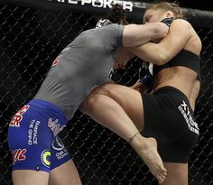 UFC 170 - Ronda Rousey wins in 1st round with knee to liver.