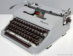 RARE OLYMPIA DE LUXE SM3 1950's GREY MANUAL TYPEWRITER WITH BURGUNDY KEYS AND ACCENTS + METAL CASE - SOLD