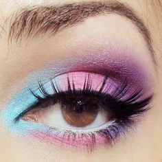 Candy-colored lids using shades of blue, pink, and purple make your eyes pop. Th… Candy-colored lids using shades of blue, pink, and purple make your eyes pop. This is perfect for daytime events as well as for night time. Eye Makeup Art, Natural Eye Makeup, Cute Makeup, Eyeshadow Makeup, Yellow Eyeshadow, Eyeshadow Palette, Sleek Makeup, Unicorn Eyeshadow, Pastel Eyeshadow