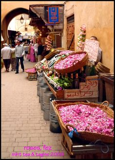 Rose and Herbs seller in a Fes souk. Morocco.