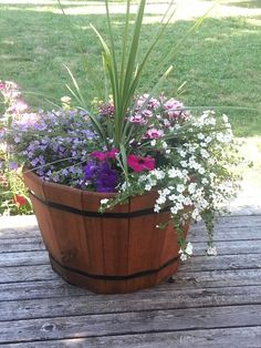 Wine barrel planter Container Flowers, Flower Planters, Container Plants, Garden Planters, Container Gardening, Wine Barrel Garden, Whiskey Barrel Planter, Whiskey Barrel Flowers, Half Barrel Planter Ideas