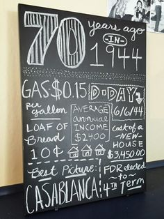"Chalkboard ""70 years ago"" decoration from dad's milestone 70th birthday party décor. Black, white, and gray chevron color scheme.  Click or visit fabeveryday.com for more planning details, inspiration, and photos from the event.  Repin if inspired!"