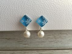 No.6518 雪の結晶のイヤリング ライトブルー 1点限り画像1