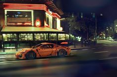 Photographer Tomek Makolski, specializing in lifestyle, fashion and cars, is developing the streets of his city using his talent for creating images. The new series of artists has six photos of the orange Lego Technic Porsche GT3 RS. Made of 2,704 pieces of LEGO, Porsche came out on the streets of Polish capital.
