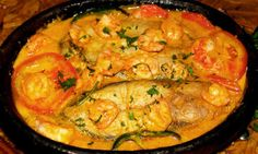 Moqueca de Peixe - Brazilian delicious food. Moqueca is a Brazilian fish stew made with various kinds of seafood, coconut milk, tomatoes, onions and more... Also this hearty stew can be made with any firm-fleshed white fish, such as catfish or halibut. Serving with fish sauce and white rice.