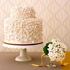Lovin Sullivan Cakes  Small blooms such as stephanotis, the only flower used in this bouquet by New York City florist Chestnuts in the Tuileries, look like a lush field of blossoms when repeated all over a wedding cake. For this creation, made of two equal-size tiers topped by a smaller one, Kate Sullivan, of New York's Lovin Sullivan Cakes, used a base of white fondant. She attached nearly 600 handmade sugar-paste flowers using royal icing.