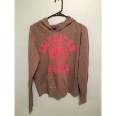 Gray and Pink AE Hoodie Love this jacket, it's in good condition! Slight cracking on lettering but other than that it's 👍🏽. The second picture is a better pic of the colors on the jacket. 🚨 Cheaper on Ⓜ️ercari! Lmk if interested on buying there. 🚨 American Eagle Outfitters Tops Sweatshirts & Hoodies