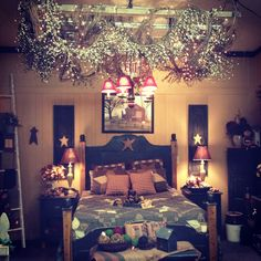 Primitive bedroom...a little bit too much for me, but beautiful!!! Love the canopy with lights over bed!