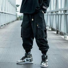 Experience supreme detail and quality on these pair of cargo pants. Crafted with premium cotton designed with hip hop, street-style inspiration. Spacious pockets and elastic leg cuffs. Mens Jogger Pants, Cargo Pants Men, Women Pants, Fashion Pants, Mens Fashion, Sporty Fashion, Fashion Beauty, Loose Pants, Loose Fit