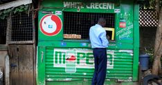 FILE - A customer conducts a transaction at a mobile money transfer stall in Nairobi, Kenya, Oct. Due to the coronavirus crisis,. Dadaab Refugee Camp, Brookings Institution, School Fees, Commercial Bank, St P, African Countries, Financial Institutions, Darwin, Kenya