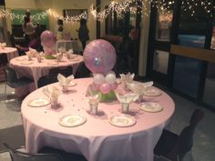 A pink Baby Shower table set up