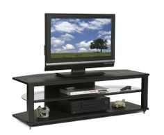 """Plateau Crx-2V 54 Bb Wood 54"""" Tv Stand, Black Oak Finish by PLATEAU. $402.49. Cable management to hide wires and cables.. Superior Modern Styling available in a natural Black Oak wood.. Heavy gauge 2"""" x 2"""" [ 51mm x 51mm ] steel tube assembly.. Glass Shelf 52.25"""" W x 16.0"""" D, Net Space Between The Tubes = 48.75"""", Top / Bottom supports 250 lbs. Middle supports 125 lbs... Middle Shelf has 3 possible shelf positions: Option 1: Middle 4.5"""" Bottom 7.75"""" H (if no Glass Shelf, 13.5"""" ..."""