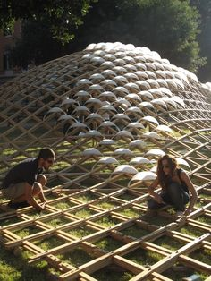 "Grid(h)ome Pavilion ""In Rome, a modular grid forms the shell of a chestnut wood…"
