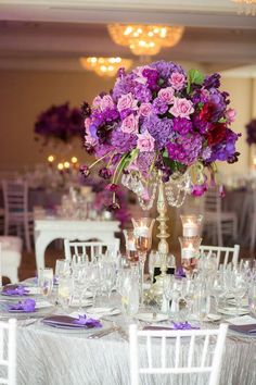 Go bold with your wedding centerpieces and check out these gorgeous purple flowers! With plenty of height and drama, these unique decorations will fit your elegant reception beautifully. Plus, you can find more inspiration with this collection of purple decorations.