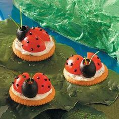 Ladybug Appetizers Recipe.. 2 ounces cream cheese, softened 2 tablespoons sour cream Black paste food coloring 1/2 teaspoon minced chives 1/8 teaspoon garlic salt 1/8 teaspoon minced fresh parsley 36 butter-flavored crackers 18 cherry tomatoes, quartered 18 large pitted ripe olives 72 fresh chive pieces (about 1-1/2 inches long) http://www.tasteofhome.com/Recipes/Ladybug-Appetizers