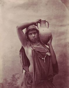 A Bedouin woman  by J. Garrigues of Tunis-check out the pins holding her apron-tunic thing-I think I could replicate this..
