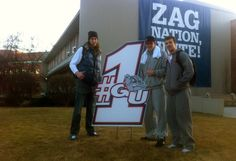 Kelly Olynik, Drew Braham, and Kevin Pangos standing next to the sign we produced for Gonzaga Bulldog's #1 national ranking. The guys make this 6 ft. sign look small. Design & Print by: Cassel Promotions & Signs. @Natalie Marr I Love Basketball, Basketball Tickets, College Basketball, Basketball Court, Kelly Olynyk, Gonzaga Basketball, Gonzaga University, Gyms Near Me, Team Player