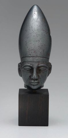 Hematite Egyptianizing head. Front view. Near Eastern. Syrian (?) Mitannian (?). 14th–13th century B.C. | Museum of Fine Arts, Boston