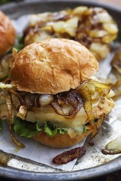French Onion Chicken Sliders - Juicy chicken mini sandwiches topped with melty swiss cheese and savory caramelized onions.