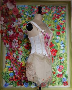 Garment with floral train by Jan Knibbs against a papier mâché panel by Liz Watts