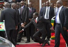 The Urban Kenyan: PHOTO OF THE DAY:Zimbabwe dictator Mugabe falls down steps, photographers forced to delete images
