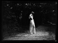 Martin Munkacsi - Woman in woods. Fashion. 1936.