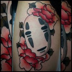 "A very serene image of No Face with some pink roses. | 24 Hauntingly Beautiful Tattoos Featuring No Face From ""Spirited Away"""