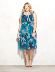 A stunning floral pattern for spring; we're loving everything about this dress from its pretty teal hues to its easy, breezy silhouette. Allover teal, navy and white floral mesh overlay. db Signature™ exclusively for DRESSBAR. Imported.