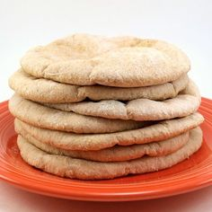 Honey Wheat Pita Bread   Yield 8 pita  1 cup whole wheat graham flour  2 cups all purpose flour  2 1/4 teaspoons dry active yeast  1 1/2 cups water, heated to 110 F  1 1/2 teaspoons salt  1 tablespoon honey  1 tablespoon canola oil