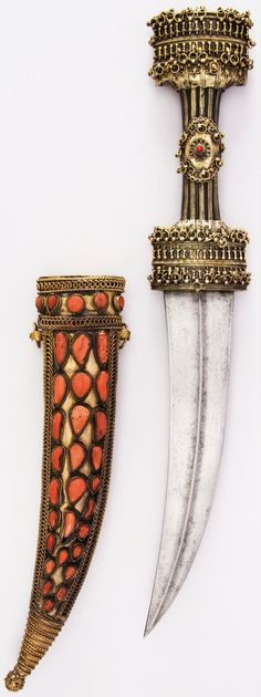 Albanian jambiya, 18th century, steel, wood, gold, brass, coral, copper, H. with sheath 18 3/8 in. (46.7 cm); H. without sheath 16 3/4 in. (42.5 cm); H. of blade 9 1/4 in. (23.5 cm); W. 2 3/4 in. (7 cm); Wt. 15 oz. (425.2 g); Wt. of sheath 9.8 oz. (277.8 g), Met Museum, Bequest of George C. Stone, 1935.