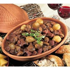 Beef bourguignon. Less bacon, more mushroom. Let stew in Romertopf for hours. Gorgeous.