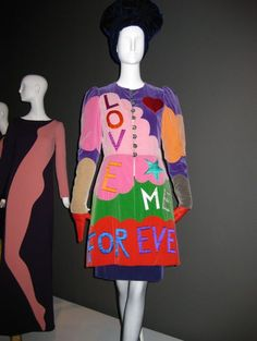 Yves Saint Laurent F/W 1966 Pop Art dress at back, and 'Love me Forever' coat at front.