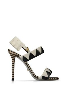 ZAGAZIG Black and white zig-zag print sandal with fringe detail and black and tan striped heel. $ 835.00 $ 418.00 50% OFF