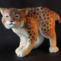 """Paper mache bobcat made with paper mache clay. I used the same method for the critters in my book """"Make Animal Sculptures with Paper Mache Clay."""""""