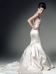 Kenneth Pool Wedding Dress  I love the shape of this dress and the bling. Just needs straps!