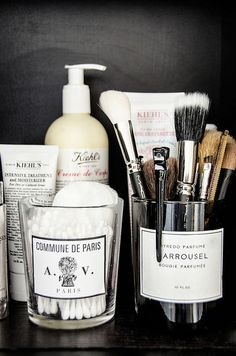 Organise in the bathroom. Love the idea of recycling a candle jar for storage. Love Byredo!