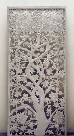 The Tree of Life conceptualized by Odyssey: Stone Architecture & Design is a double height mural carved in mint white sandstone.