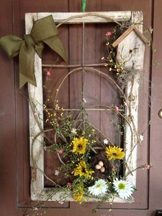 15 Creative and Unique Spring Wreath Ideas - Wildflowers and.- 15 Creative and Unique Spring Wreath Ideas – Wildflowers and Wanderlust Using an old window and florals is a great way to decorate your front door for spring Old Window Decor, Old Window Frames, Window Frame Ideas, Window Frame Crafts, Frames Ideas, Repurposed Window Ideas, Rustic Window Frame, Window Pane Art, Front Door Decor