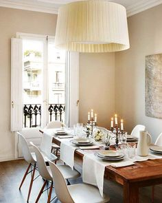 Old table ,modern chairs  & white linens *