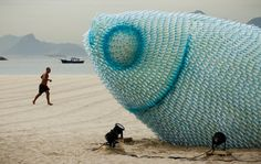 A man runs on Botafogo beach near a huge sculpture made from plastic bottles in Rio de Janeiro, Brazil, Tuesday, June 19, 2012. The city is host to the UN Conference on Sustainable Development, or Rio+20, which runs through June 22. (AP Photo/Victor R. Caivano) AP