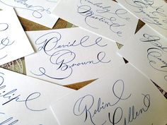 Letters By Anat calligraphy. Blue ink on white paper place cards