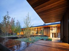 This striking home is a modern art piece designed by Carney Logan Burke Architects, set on the banks of the Snake River in Jackson, Wyoming. Green Bedroom Colors, Outdoor Spaces, Outdoor Living, Logan, Glass Showcase, Teton Mountains, Mountain Modern, Mountain Range, Aspen Trees