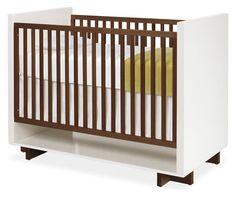 Moda crib. In walnut and white.