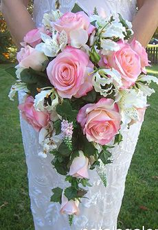 Cascading rose bouquet placed in pew clips for the church! Perfect <3