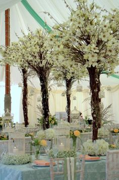 styling of a traditional marquee using flower trees from essential wedding hire, chair slips from @Allison j.d.m House of Bunting flowers by @dandelionfloristry - www.finesseplanning.co.uk